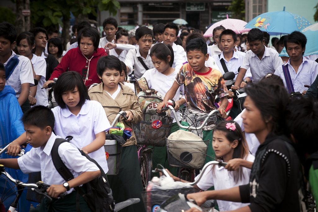 Students return home from school in Tachilek, Myanmar. Photo by United Nations Photo, via Flickr. Licensed under CC-BY-ND-2.0.