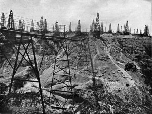 """Oil wells in Yenangyaung during the early 20th century.  Photo taken from  """"Twentieth century impressions of Burma : its history, people, commerce, industries, and resources"""" Arnold Wright, 1910. Public domain."""